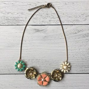 Gold chain with various studded flowers